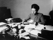 FRANCE - JANUARY 02:  The French Writer Simone De Beauvoir Seated, Reading At Her Desk In 1953.